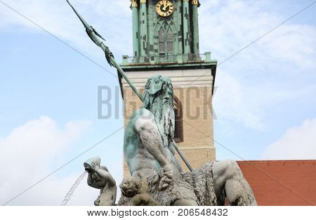 Statue Of Neptune The God Of The Mari In The Big Square In Berli