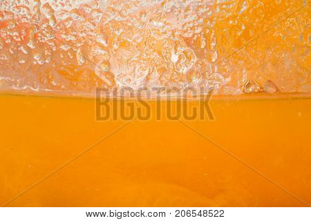 background of apricot jam. macro . Photo of an abstract texture