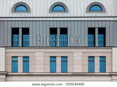 Several windows in a row on facade of urban office building front view St. Petersburg Russia