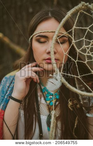 Portrait of a young hipsters girl .dreamcatcher