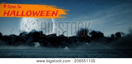 Graphic image of time to Halloween text against view of sea at night