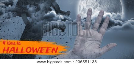 Graphic image of time to Halloween text against hand by side of celtic cross in front of moon