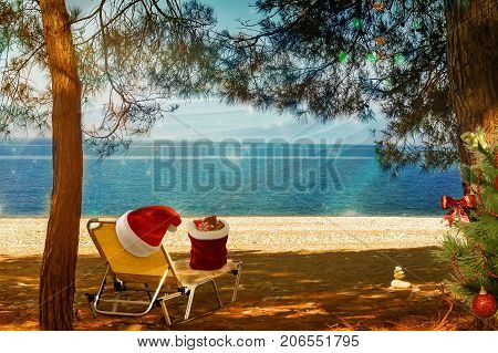 Christmas beach: on the beach on a sun lounger is a gift, next to the hat of Santa Claus and Christmas tree. 3 D rendering.