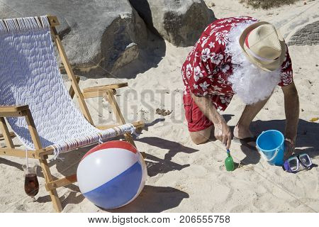 Santa Claus Digging In Sand With Pale And Shovel