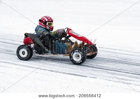Winter karting competition on the ice track