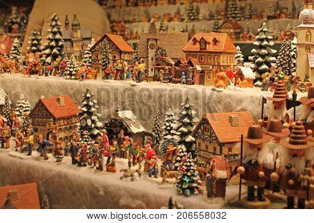 Christmas decoration on advent market. Christmas decoration on advent market. Decorative miniature city houses. -- Stock Photo #165336524 Christmas decoration for sale on advent market. Decorative miniature city houses. Austria,Salzburg.