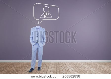 Headless businessman standing with hands in pockets against room with wooden floor