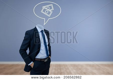 Headless businessman with hands in pockets against room with wooden floor