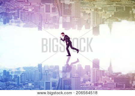 Running businessman with reflection on abstract upside down rainbow city background. Lifestyle concept