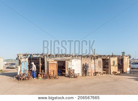 WALVIS BAY NAMIBIA - JULY 1 2017: Wood carving shops at the waterfront in Walvis Bay on the Atlantic Coast of Namibia