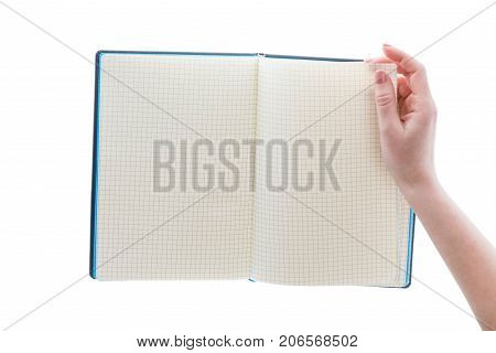Hand open diary notebook for notes. Female hand opened page of notebook in cell for writing diary blank page for education lesson in school paper for mathematics. Back to school for math science