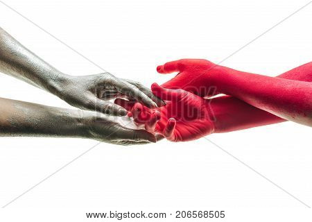 Friendship trust equality and touch of hands. Human hands male and female finger touch art and understanding between people. Four gray and red hands on a white background isolated. Arm and palm
