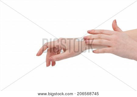Hands with cream. Woman applying moisturizing cream on hands. Beautiful young woman hands with white cream isolated on white. ?are for the skin of the hands. Female hands care