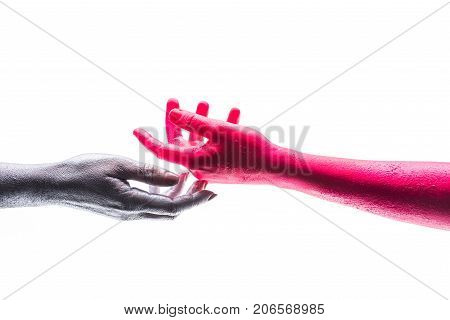 Support hands on white background isolated silver and red human hand. Gentle touch trust. Art project creative self expression. Different colors and different races. Paints and color science
