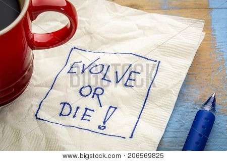 Evolve or die napkin doodle with a cup of coffee