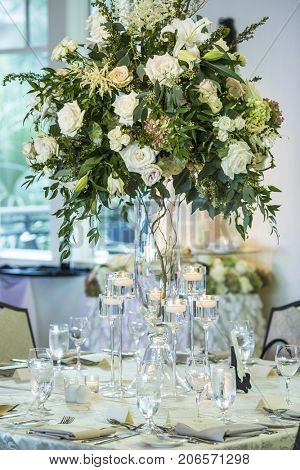 Extravagant floral table decoration for wedding reception