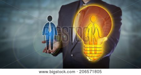 Unrecognizable recruiter is presenting a bright recruitment choice in form of a worker icon inside a lightbulb. HR concept for talent management promotion leadership career move and success.