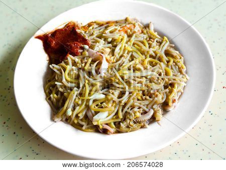 Singapore Hokkien mee is a popular local cuisine in Malaysia and Singapore that has its origins in the China's Fujian province. The dish consists of egg noodles and rice noodles stir-fried with prawns calamari eggs pork and served with sambal chilli