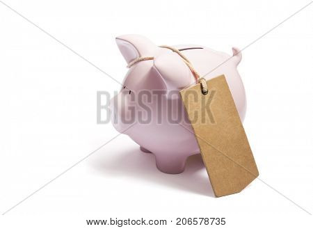 Piggy bank with blank tag tied with string