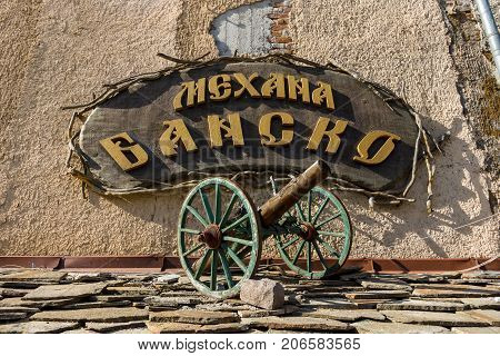 BURGAS BULGARIA - AUGUST 20 2017: Signboard of the Bulgarian cuisine restaurant Mechana Bansko close-up. Burgas is the second largest city on the Bulgarian Black Sea Coast.