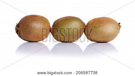 Close-up of fresh whole kiwi, isolated on a white background. Juicy kiwi fruit. Exotic kiwi full of beneficial vitamins. Kiwi fruit is a fruit with a thin hairy skin, green flesh, and black seeds.