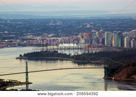 Vancouver British Columbia Canada city skyline by Stanley Park Lions Gate Bridge scenic view