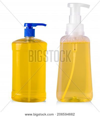 orange plastic bottles with liquid laundry detergent cleaning agent bleach or fabric softener isolated on white background