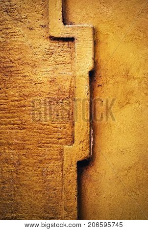 abstract background cornice detail on an old ocher wall