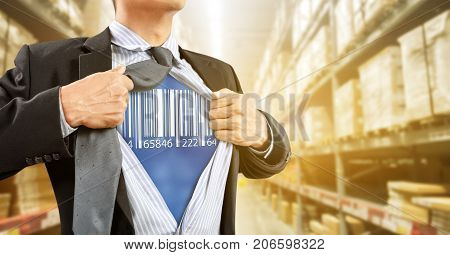 Businessman with barcode reader in warehouse, logistics