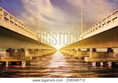 Long bridge cross over the big river or the sea for support transportation and travel between land or the city. The bridge under engineering design and designed by modern design.