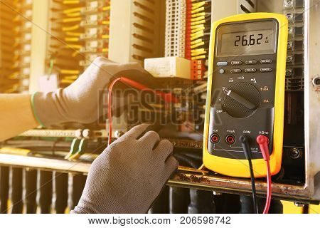 Electrical terminal in junction box and service by technician. Electrical device install in control panel for support program and control function by PLC. routine visit check equipment by technician. poster