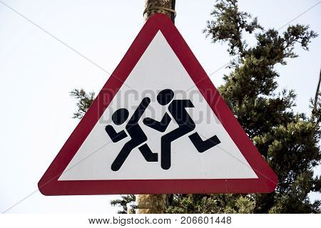 Road sign of running children through the bypass road