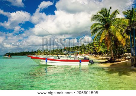 White and red boat on the shore of one of the Caribbean Islands, Dominican Republic, Caribbean Islands, Central America