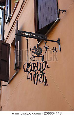 Vignola Italy - October 30 2016: Original signboard of Castello di Carta bookshop. Emilia-Romagna Modena