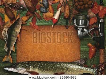 Fishing tackle on vintage wooden background. Toned image