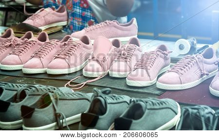 shoe making process in footwear factory workshop with lens flare technic