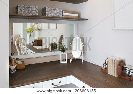 Decoration of dressing table with earth tone color. wooden dressing table and mirror.