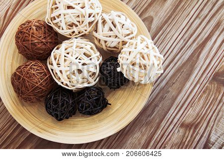 Rattan ball on wooden plate for decoration.