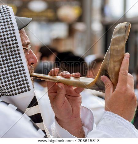 Jewish hasid blows Shofar. Uman Ukraine - 21 September 2017: Rosh Hashanah Jewish New Year.