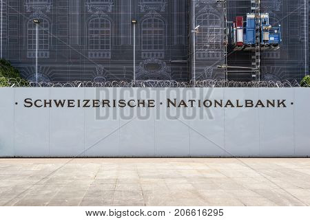 Bern Switzerland - May 26 2016: Repair of the facade of the Swiss National Bank in Bern Switzerland. Building facade covered for restoration work.