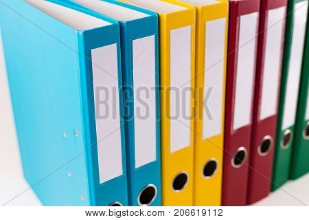 Detail of colorful ring binder in a row.
