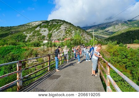 CANYON OF RIVER MORACA MONTENEGRO - SEPTEMBER 12 2017: Unknown tourists are on bridge over canyon of river Moraca Montenegro