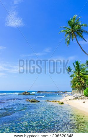View of a beautiful tropical beach. Black beach in Varkala, India