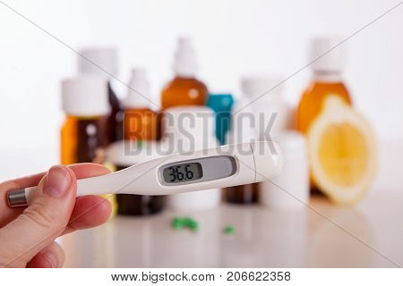 Drug prescription for treatment medication. Pharmaceutical medicament cure in container for health. thermometer with a temperature of 36.6