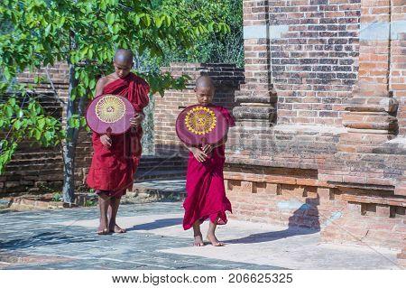 BAGAN MYANMAR - SEP 05 2017: Novice monks in bagan Myanmar on September 05 2017 The ruins of Bagan has 2200 temples and pagodas