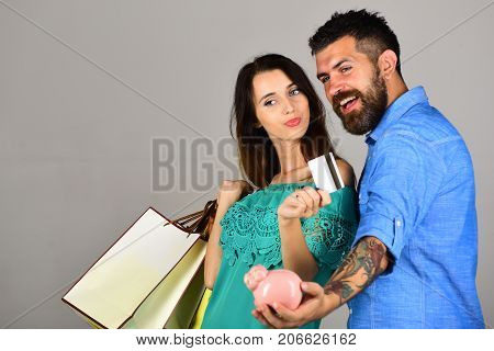 Shopping And Free Time Concept. Couple Holds Shopping Bags