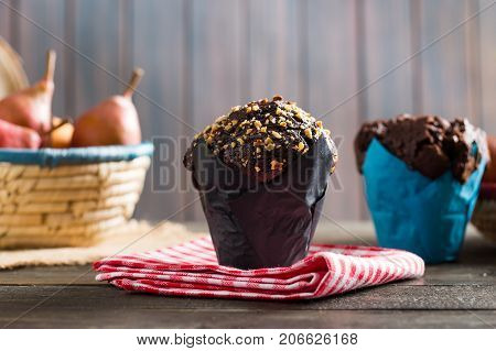 Tasty Chocolate Muffins on Rustic Woden Table