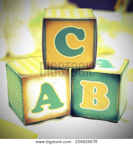 three letter of the alphabet written on cubes of an old elementary school