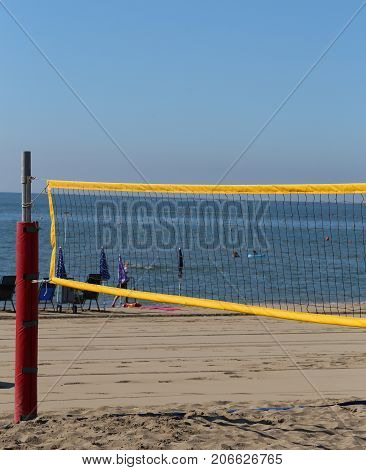 sport net on the beach for playing beach volley during summer vacation by the sea