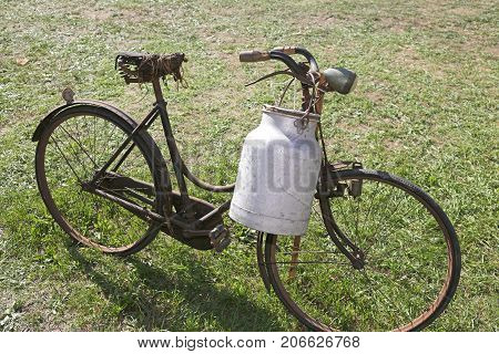 Old Bicycle With Aluminum Milk Bin To Carry Milk